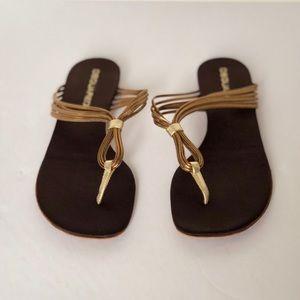 Metallic bronze thong sandals.